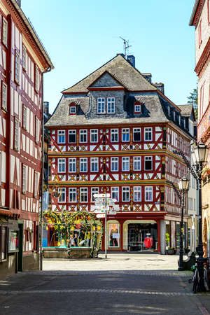 Herborn, Germany - April 22nd 2019: Half-timbered houses on Marketplace (Marktplatz) in Herborn. Hessen, Germany
