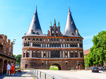 12 aug 2020: Holsten gate in Lübeck, most popular gate in Germany. Text on the gate in English: 1477. SPOL 1871. Editorial