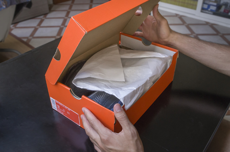 Opening the box of a new pair of shoes 版權商用圖片