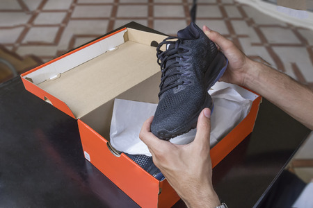 Opening the box of a new pair of shoes 스톡 콘텐츠