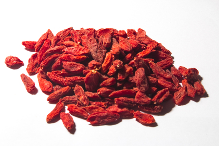 berryes: GOJI berryes pile, over white isolated