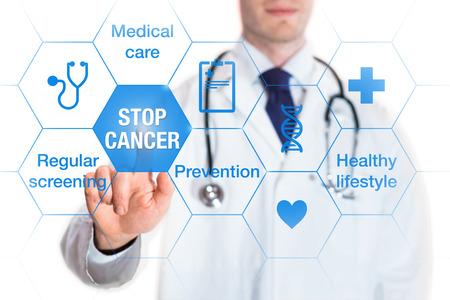 アイコンや画面とボタンに触れる医師の言葉でがん予防と意識の概念 写真素材