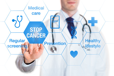 Cancer prevention and awareness concept with icons and words on screen and medical doctor touching a button