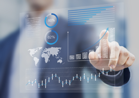 Businessman touching financial dashboard with key performance indicators