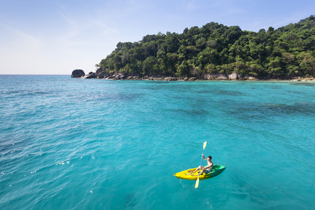 Young adult having fun with kayak in turquoise paradise sea Stock Photo