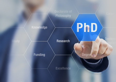 PhD student pushing button about Doctorate of Philosophy concept Foto de archivo