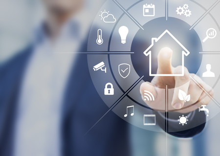 Circular futuristic interface of smart home automation assistant on a virtual screen and a user touching a button Standard-Bild