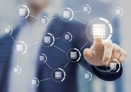 Data and server networks concept with a person touching a digital interface with icons linked together to symbolize transfer of information Stock Photo