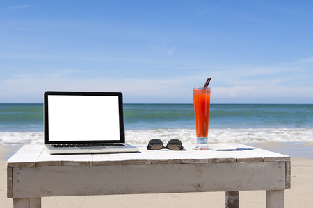 Working on the beach, white blank screen for copy-space