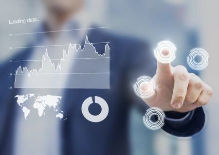 Head-up display interface showing business intelligence dashboard and charts with businessman fingers touching virtual buttons Stock Photo