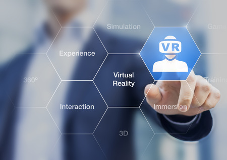 Virtual reality concept with icon of VR headset on a digital interface and a businessman touching a button