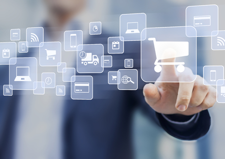 E-commerce concept with a person touching a button on a digital interface with icons of shopping cart, delivery truck and credit card, symbol of online purchase on internet