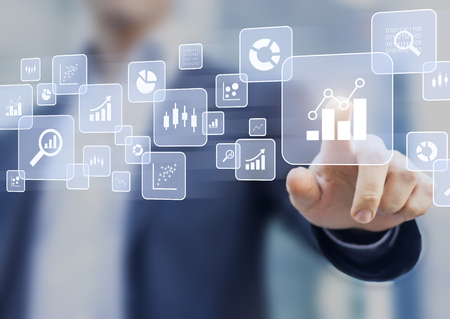 Big data analytics and business intelligence (BI) concept with chart and graph icons on a digital screen interface and a businessman in background Standard-Bild
