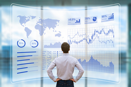 Person using a futuristic head up display (HUD) interface screen with data and key performance indicators (KPI) for business intelligence (BI) analytics, concept about financial dashboard, technology and virtual reality (VR)