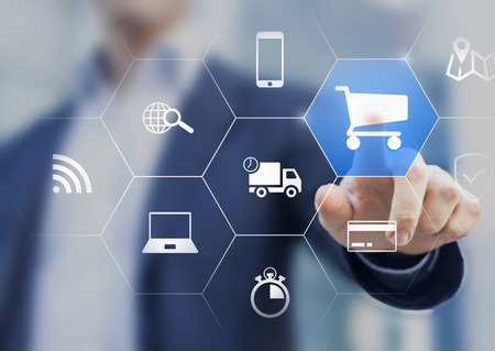 ecommerce icons: Businessman touching e-commerce button on a virtual interface with icons of shopping cart, delivery, credit card and wireless web, concept about online purchase on internet Stock Photo