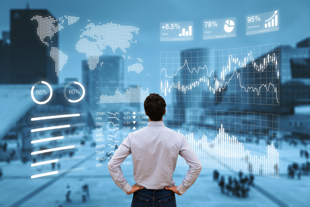 Person analyzing a financial dashboard with key performance indicators (KPI) and business intelligence (BI) charts with a business district cityscape in background