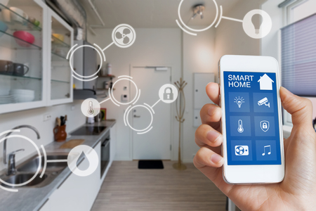 Smart home interface on smartphone app screen with augmented reality (AR) view of internet of things (IOT) connected objects in the appartment interior, person holding device Banco de Imagens - 84626493