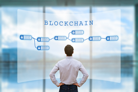 Person looking at blockchain concept on screen as a secured decentralized ledger for cryptocurrency financial technology and business transaction data, fintech