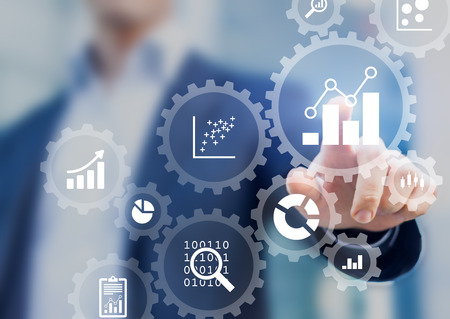 Business data analytics process management with a consultant touching connected gear cogs with KPI financial charts and graph, automated marketing dashboard Archivio Fotografico