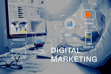 Concept of digital marketing media (website ad, email, social network, SEO, video, mobile app) with icon, and team analyzing return on investment (ROI) and Pay Per Click (PPC) dashboard in background