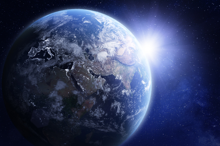 3D render of planet Earth viewed from space, with night lights in Europe and sun rising over Asia. Blue hue treatment. Stock Photo