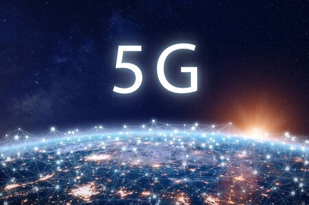 5G mobile internet telecommunication network with high speed wireless data connection technology for smartphones and IoT. Fifth generation system deployment concept with Earth viewed from space 写真素材
