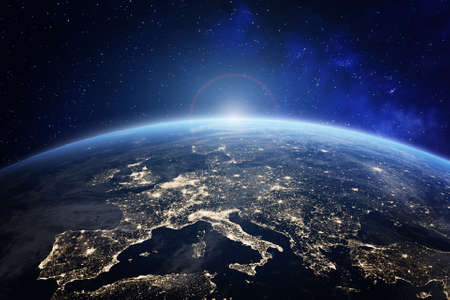 Planet Earth viewed from space with city lights in Europe. World with sunrise. Conceptual image for global business or European communication technology Standard-Bild