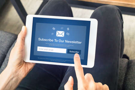 Subscribe to newsletter form on tablet computer screen to join list of susbscribers and receive exclusive offers and update. Digital communication marketing and email advertising. Membership sign-up Stockfoto