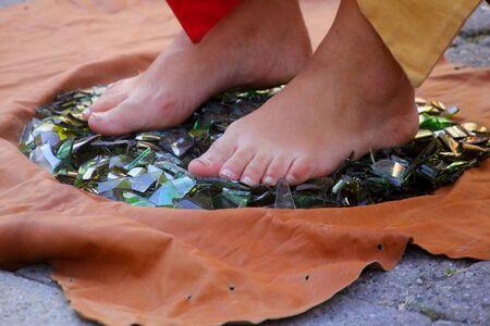 broken foot: feet on broken glasses,