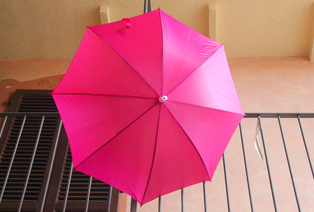 balcony: a pink umbrella on the balcony