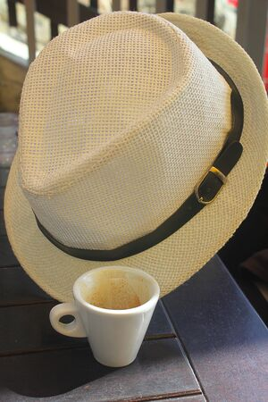 expressed: a cup of coffee and an hat Stock Photo