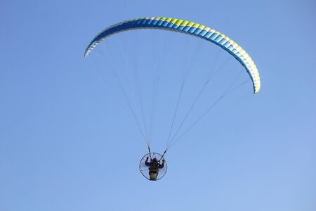 engine powered: a flying paragliders in the sky Stock Photo