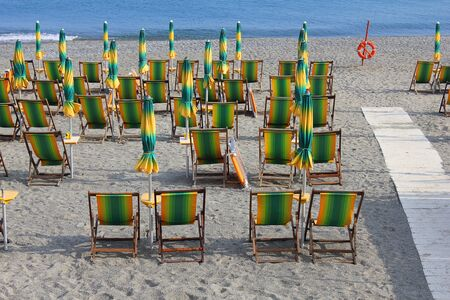 deck chairs: some deck chairs on the sand