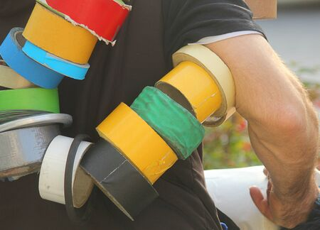masking tape: a man who is carrying colored masking tape