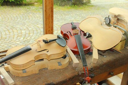 fiddles: some violins handmade in a laboratory