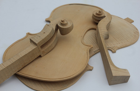 fiddles: some violin parts under construction Stock Photo