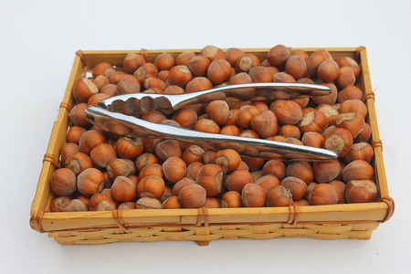 filbert nut: a basket with hazelnuts and nutcracker