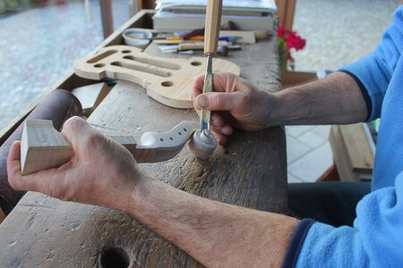 fiddles: violin under construction in a laboratory