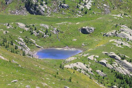 an alpine lake in mountain in Summer in Italy Standard-Bild - 127530866