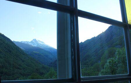 a panorama of mountains through the window Standard-Bild