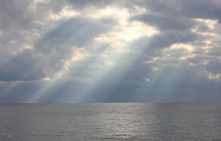 sunbeams through the clouds over the sea
