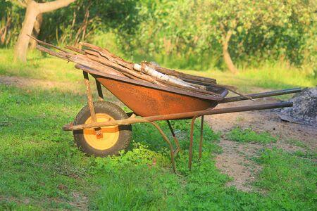 a wheelbarrow with wood Standard-Bild