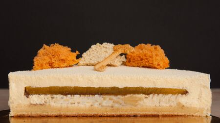 Section in a vanilla cake with orange sponge