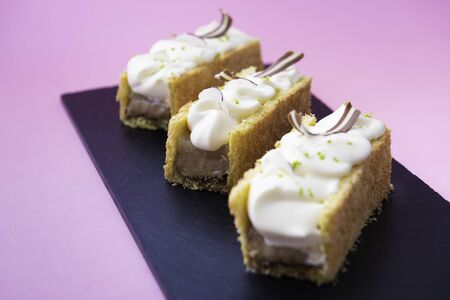Le Coco cake with duo chocolate, lime cream, coconut and crunchy layer
