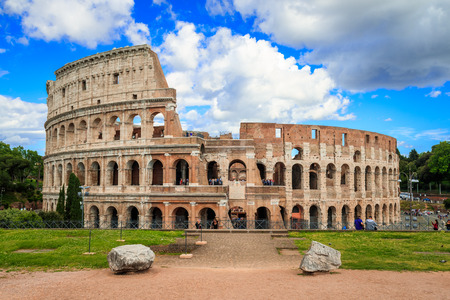 Colosseum with clear blue sky and clouds, Rome. Rome architecture and landmark. Rome Colosseum is one of the best known monuments of Rome and Italy