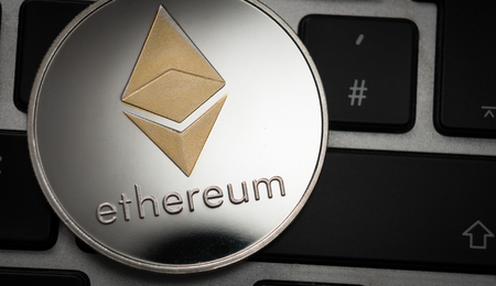 Cryptocurrency Ethereum coin on computer laptop keyboard. Finance, investment and money concept Imagens