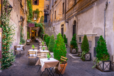 Cozy street in downtown in Rome, Europe. Touristic attraction of Rome Imagens