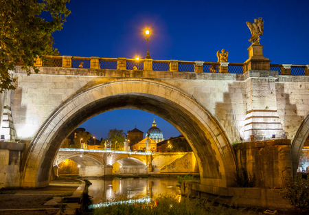 Night view of Ponte Sant Angelo, Holy Angel Bridge, and Tiber in Rome, Italy, Europe Imagens