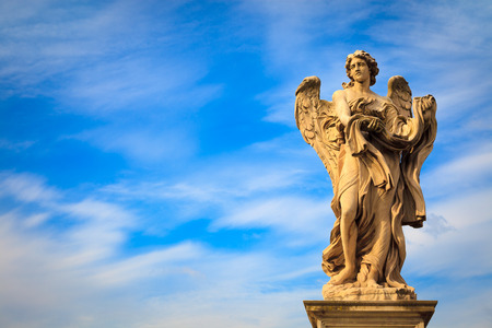 Angel statue along SantAngelo bridge in Rome. the bridge leading to Rome Castel SantAngelo is adorned with ten beautiful Baroque statues of angels