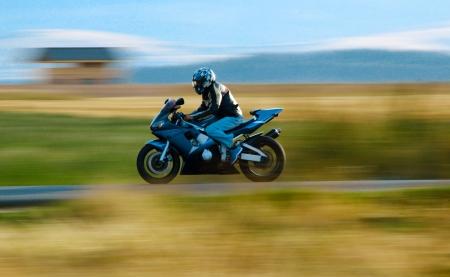A motorbike speed on the street Stock Photo